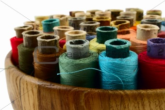 threads in wooden plate
