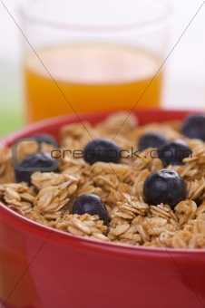 Bowl of Granola and Blueberries and Juice