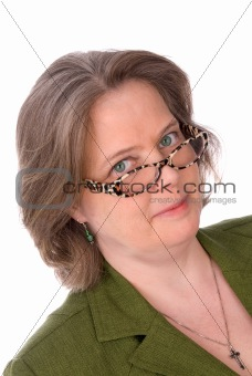 Older Irish woman with green eyes and glasses