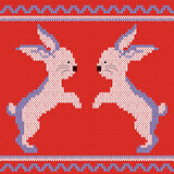 Knitted pattern with rabbits
