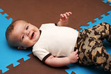 Infant Boy On Play Mat