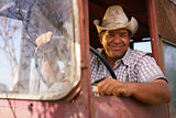 Portrait Happy Man Farmer Driving Tractor Looking At Camera