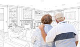 Senior Couple Looking Over Custom Living Room Design Drawing