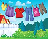 Clothes on clothing line theme image 1