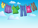 Clothes on clothing line theme image 2