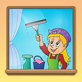 Woman cleaning window image 1
