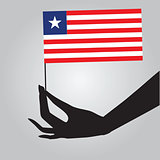 Hand with flag Liberia