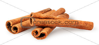 Three cinnamon sticks lying cross