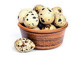 Quail eggs in a ceramic bowl.