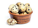 Quail eggs in a ceramic bowl.