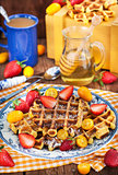 Belgian pumpkin waffles decorated with fresh fruits