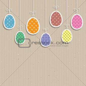 Easter eggs on cardboard texture