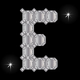 Metal letter E. Gemstone. Geometric shapes