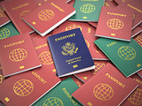 Passport of USA on the pile of different passports. Immigration
