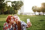 Two Young Hipster Girls Taking Selfie