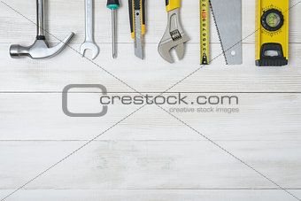 Top view of construction instruments and tools on wooden DIY workbench. with open space.