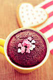 chocolate mug cake and heart-shaped cookie, filtered