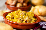 spanish guiso de patatas con albondigas, a stew with potatotes a