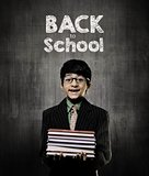 Back To School. Genius Little Boy Holding Books Wearing Glasses