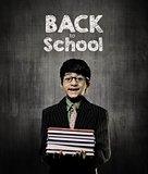 Back To School. Genius Little Boy Holding Books Wearing Glasses