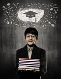 Graduation Cap. Genius Boy Holding Books Wearing Glasses,  Chalk