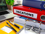 Red Ring Binder with Inscription Vacations.