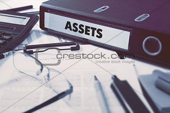Assets on Office Folder. Toned Image.