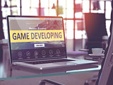 Game Developing Concept on Laptop Screen.
