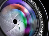 Video Advertising on Black Digital Camera Lens. Closeup.