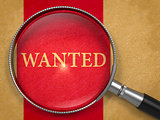 Wanted through Lens on Old Paper.