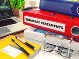 Summary Statements on Red Office Folder. Toned Image.