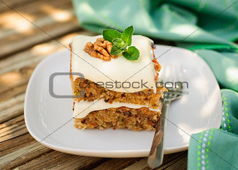 A Piece of Moist Zucchini and Walnut Cake with Cream Cheese Fros
