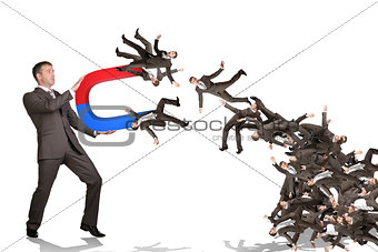 Businessman catching people on magnet