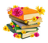 Pile of books with flowers