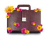 Brown suitcase with flowers