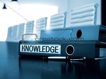 Knowledge on File Folder. Blurred Image.