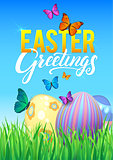 Easter eggs in Fresh Green Grass. Decorated Easter Eggs in Grass on Sky Background. Happy Easter Calligraphy Poster Template