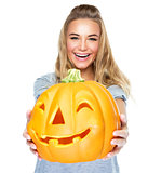 Happy female with Halloween pumpkin