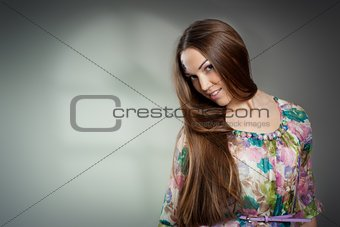 Portrait of beautiful young woman wiht long hair