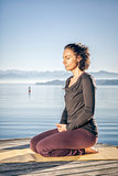 yoga woman sitting lake