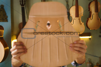 Artisan Lute Maker Chiseling Guitar Inspecting Holes In Acoustic