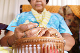 Senior Woman In Old People Home Knitting Whool