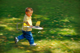 Boy Running with Toy Airplane