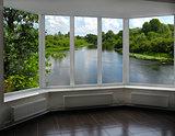 modern window of veranda overlooking the river