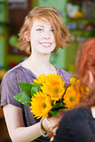 Teen Girl in Flower Shop Purchases Sunflowers