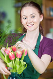 Smiling Female Florist Creating Tulip Arrangement
