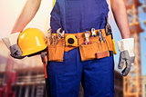 construction worker with tool belt at building site