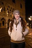 Portrait of happy woman tourist on St. Mark's Square in Venice