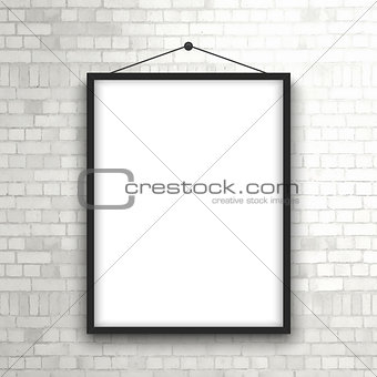 Blank picture frame on brick wall