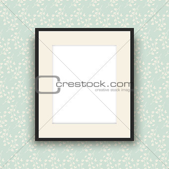 Blank picture frame on vintage style wallpaper
